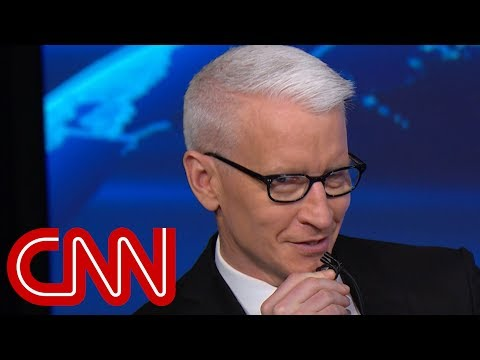 Anderson Cooper mocks Omarosa whispering about Trump