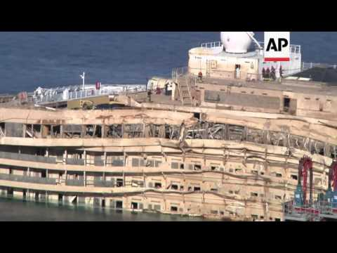 Divers begin search of Costa Concordia shipwreck, looking for bodies of 2 still missing