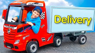 Artem plays delivery service on kids toy truck