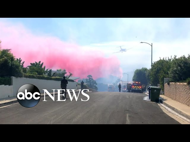 Firefighters wage battle against growing Southern California fires