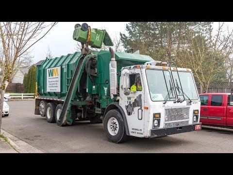 Mack LE - Amrep Octagonal Side Load Garbage Truck