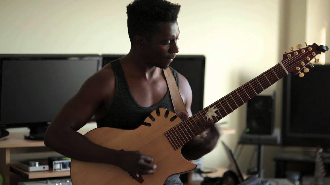 tosin abasi plays julien bergeron 8 acoustic 8 string guitar