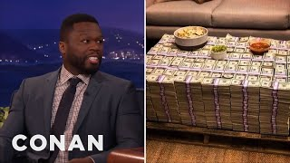 why is curtis 50 cent jackson posing with cash if hes broke? conan on tbs