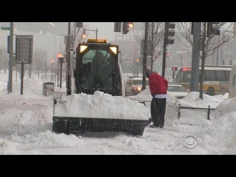 Boston digs out from new snow record