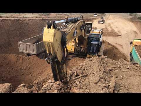 Cat 365C L Excavator Loading Trucs With 3 Passes