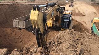 Cat 365C L Excavator Loading Trucs With 3 Passes
