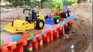 ทำถนนลาดยางบนสระพาน รถดั้มบรรทุกทราย รถเกรด รถบดดิน รถของเล่นก่อสร้าง