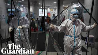 Wuhan hospitals under pressure as coronavirus is 'getting stronger'