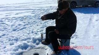 Ice fishing on lake Baikal