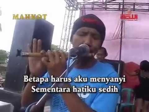 DERITA DI BALIK TAWA ~ [KAR] BRENGGOLO musik [metro]