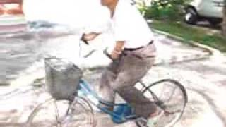Man Who Lost Arms to Bomb Rides Bike