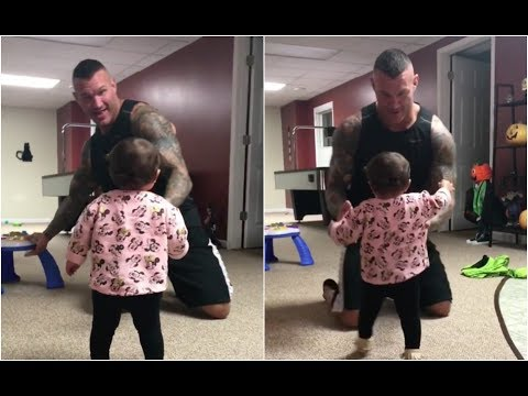 Randy Orton playing with his daughter before going to Smackdown