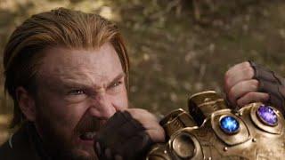 Капитан Америка держит перчатку  Таноса. Битва за камень разума! Мстители Война Бесконечности