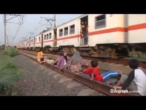 Indonesians risk lives in railway 'track therapy' craze
