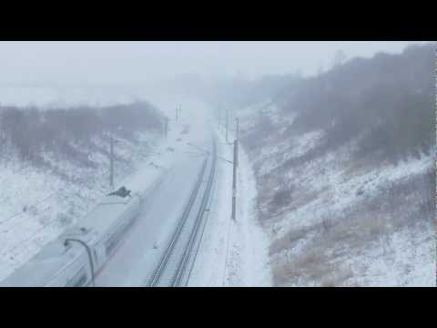 Thumbnail: ICE meets ice High speed trains blows snow away
