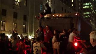 Fans ride a truck by Union Station after Raptors win NBA Championship