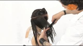 Женская стрижка на длинных волосах.