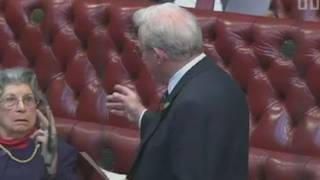 RUDE PEER: Baroness Trumpington gives Lord King the v-sign