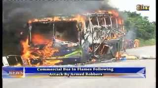 Commercial bus in flames following attack by armed robbers