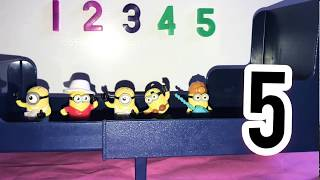 5 little minions jumping on the bed