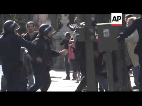 European Finance - Tear Gas Fired As Protesters, Some In Nazi Regalia, Voice Anger At Merkel Visit /
