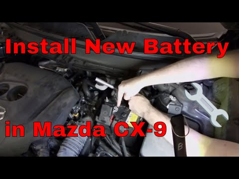 How to install a new battery on a Mazda CX-9