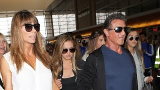 Sly Stallone Has A Cheering Squad At LAX