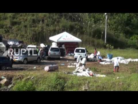 Colombia: Families search for loved ones at cemetery as mudslide death toll grows