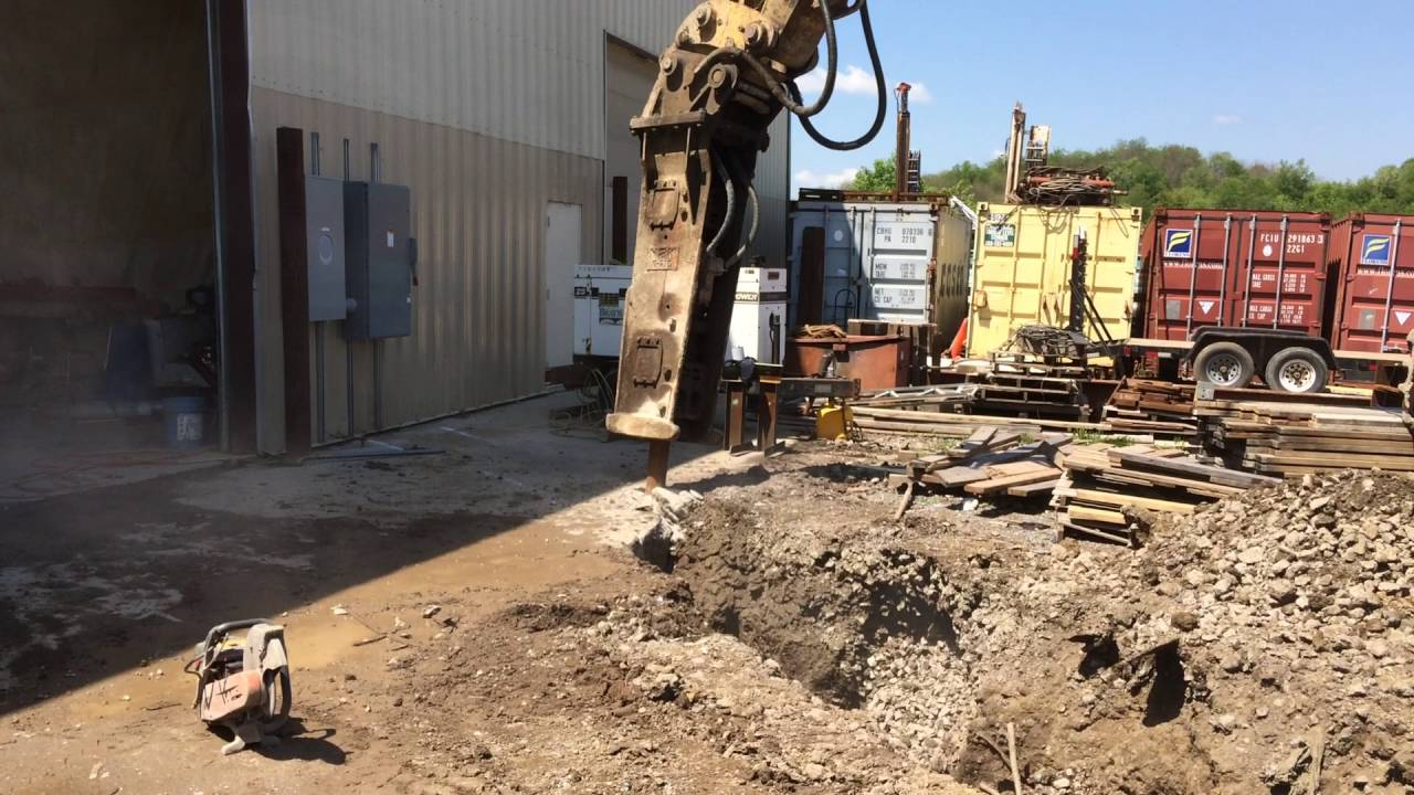 Using A Hoe Ram To Break Up 24 Thick Concrete Slab For Electrical