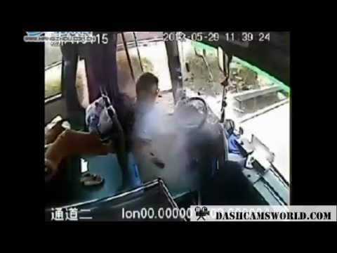 *Graphic* *Raw footage* Bus Driver Struck by Flying Debris
