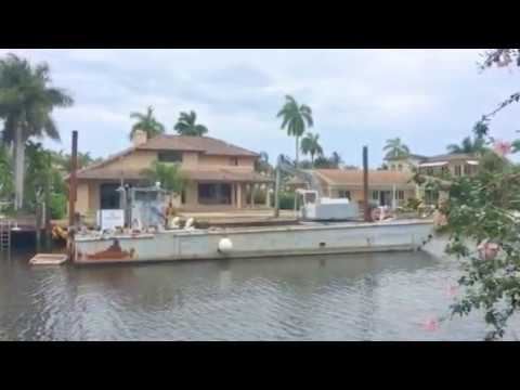Construction in Ft Lauderdale. Floating Power Howe dredging the homes dock