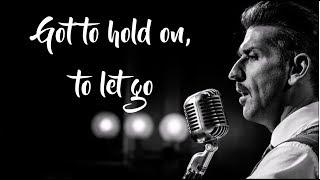 Danny Vera - Hold On To Let Go (Lyrics Video)