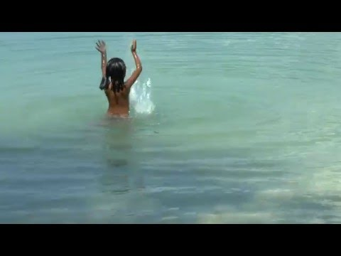 Children are the future. Thai girl playing and swimming at a beach