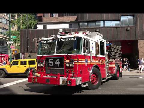 FDNY ENGINE 54 RESPONDING FROM QUARTERS IN THE MIDTOWN AREA OF MANHATTAN IN NEW YORK CITY.