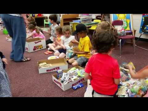 """In Hamden, West Woods School kindergarteners assemble """"blessing bags"""" filled with toiletries and sna"""