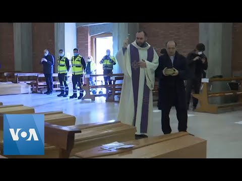 Italian Priest Blesses Coffins Awaiting Cremation