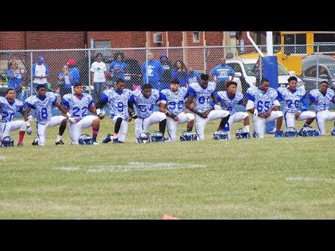 Proviso East football team kneels during National Anthem