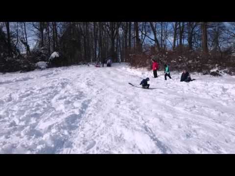 Snow sledding at Westmore school playground
