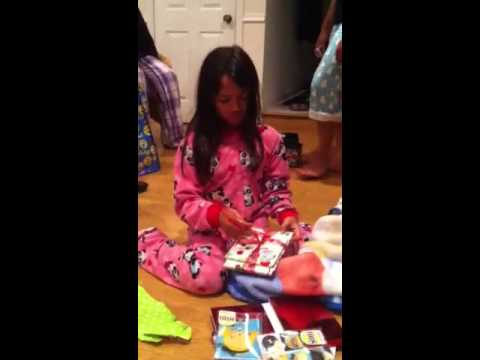 Jana opens her OneDirection Christmas gift from aunti Kay.