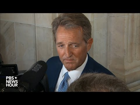 Sen. Jeff Flake answers questions after announcing he won