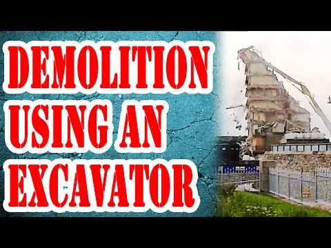 Excavator Demolition  with building collapse - Contractors demolish Hotel with high reach excavator