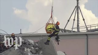 Italy: Rescuers work to free bridge collapse victims