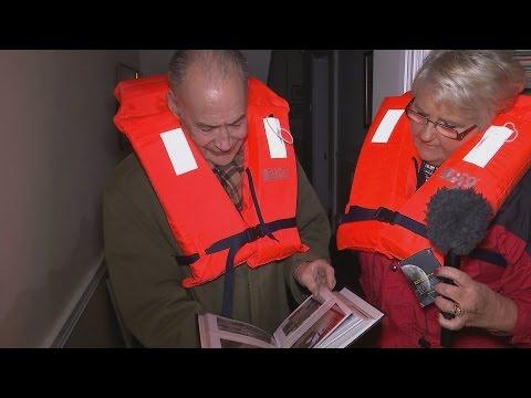 Alastair Stewart inspects the damage of a flood-stricken home