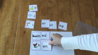 Making short vowel e words with cards.