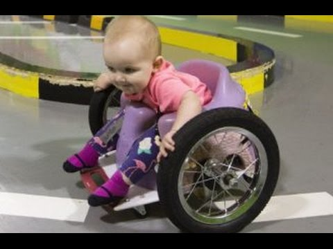 Baby's parents make a DIY wheelchair after she is paralysed by a tumour ...