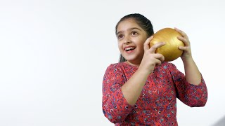 Smart Indian girl saves her money in a golden money bank - learning the value of money