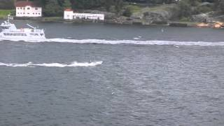 crazy driver on oslo fjord: small boat vs big waves