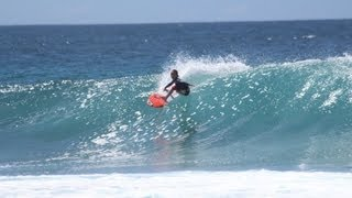 8-year old Kobi surfing in Maldives on board The Perfect Wave COBIA surf charter
