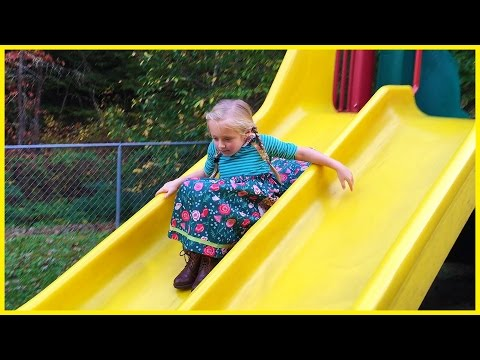 Playing at the Playground Park for Kids on Slides, Swings, Tire Swing, Teeter Totter See Saw