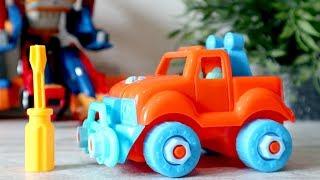 - Тобот Тритан и его автосервис. Собираем машину. Видео с игрушечными машинками